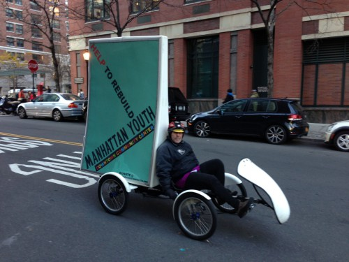 Manhattan Youth cycle sign