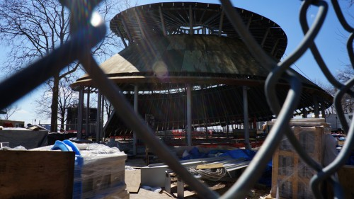 battery park carousel in progress through fence