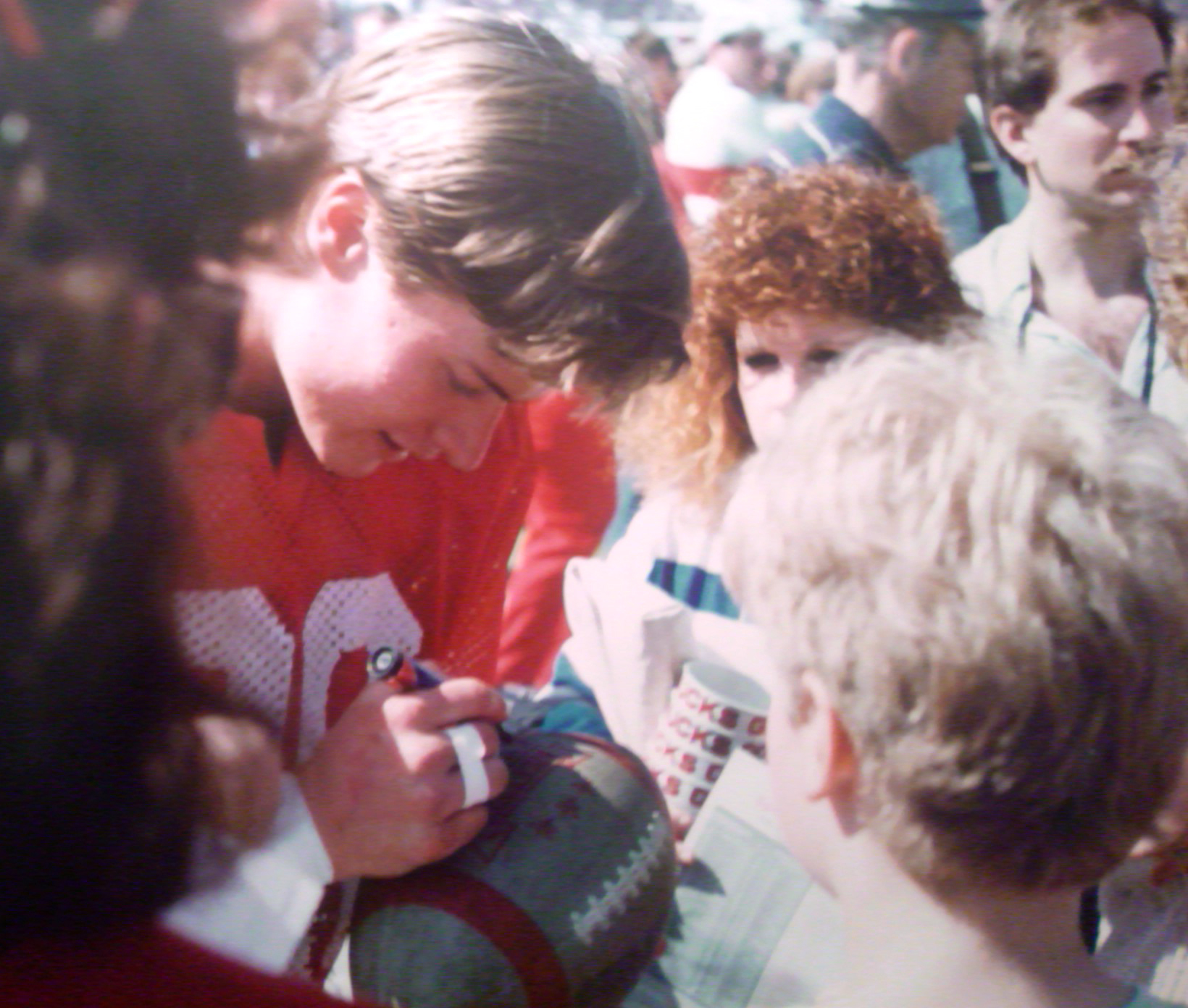 Autographing football 1988 color corrected