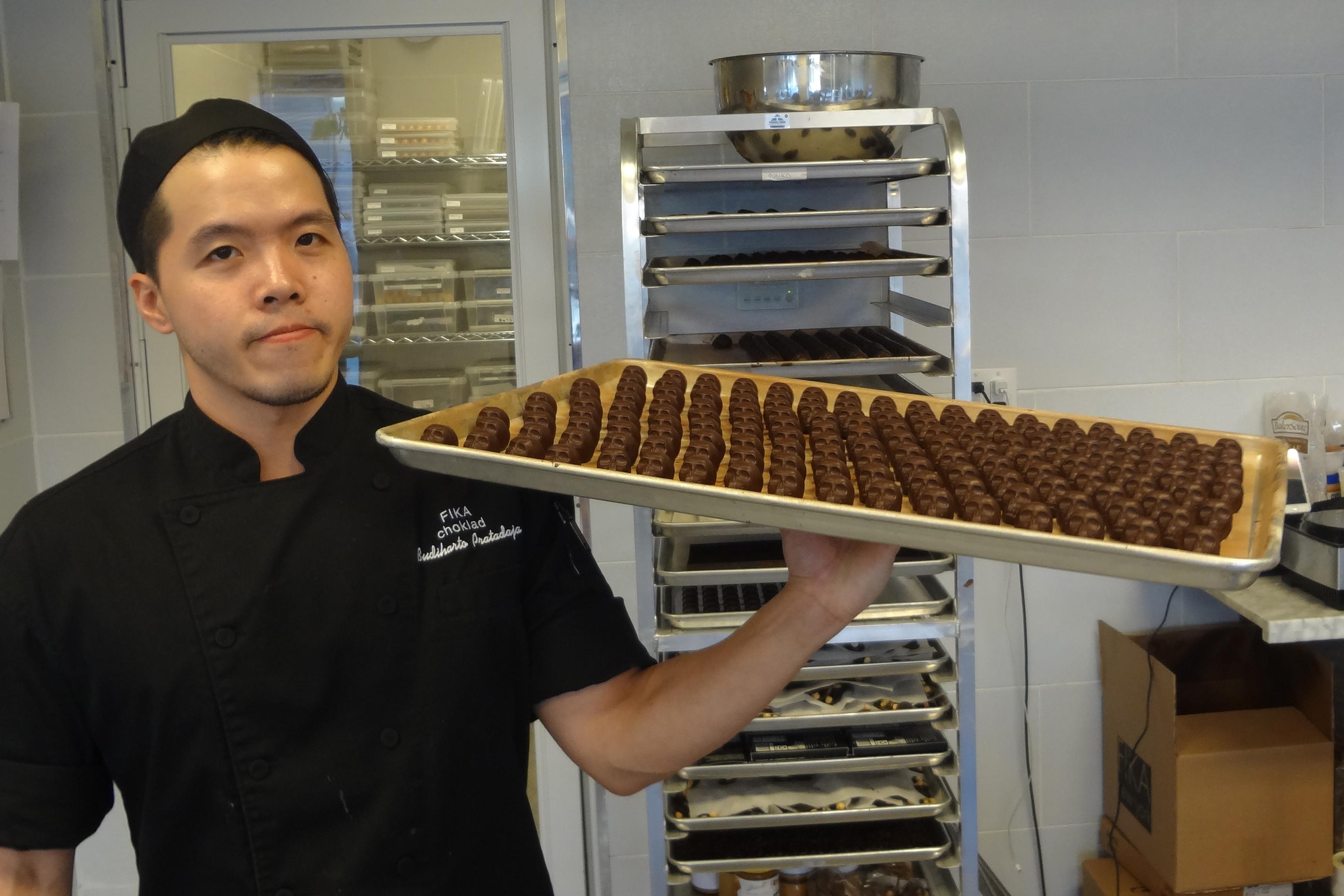 Chocolate skulls on tray man holding