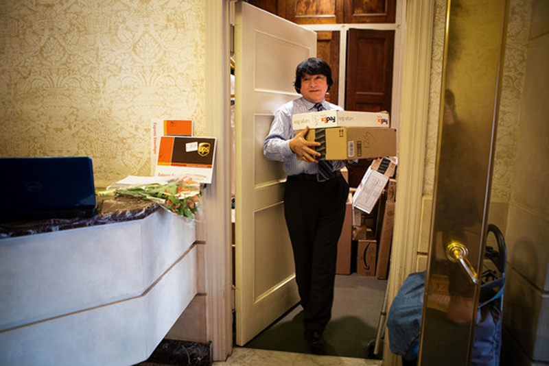 Doorman with boxes