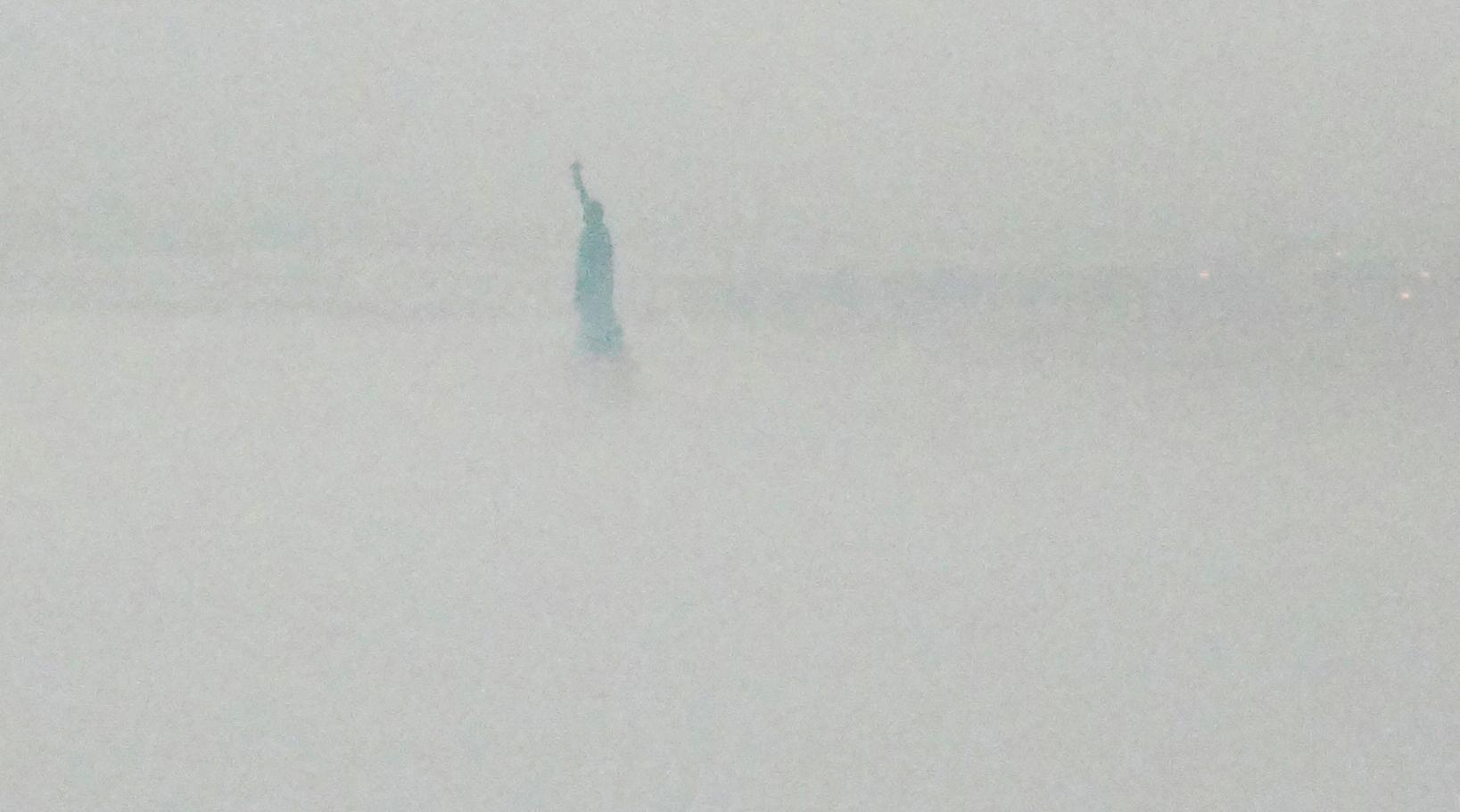 Staue of Liberty fog close crop