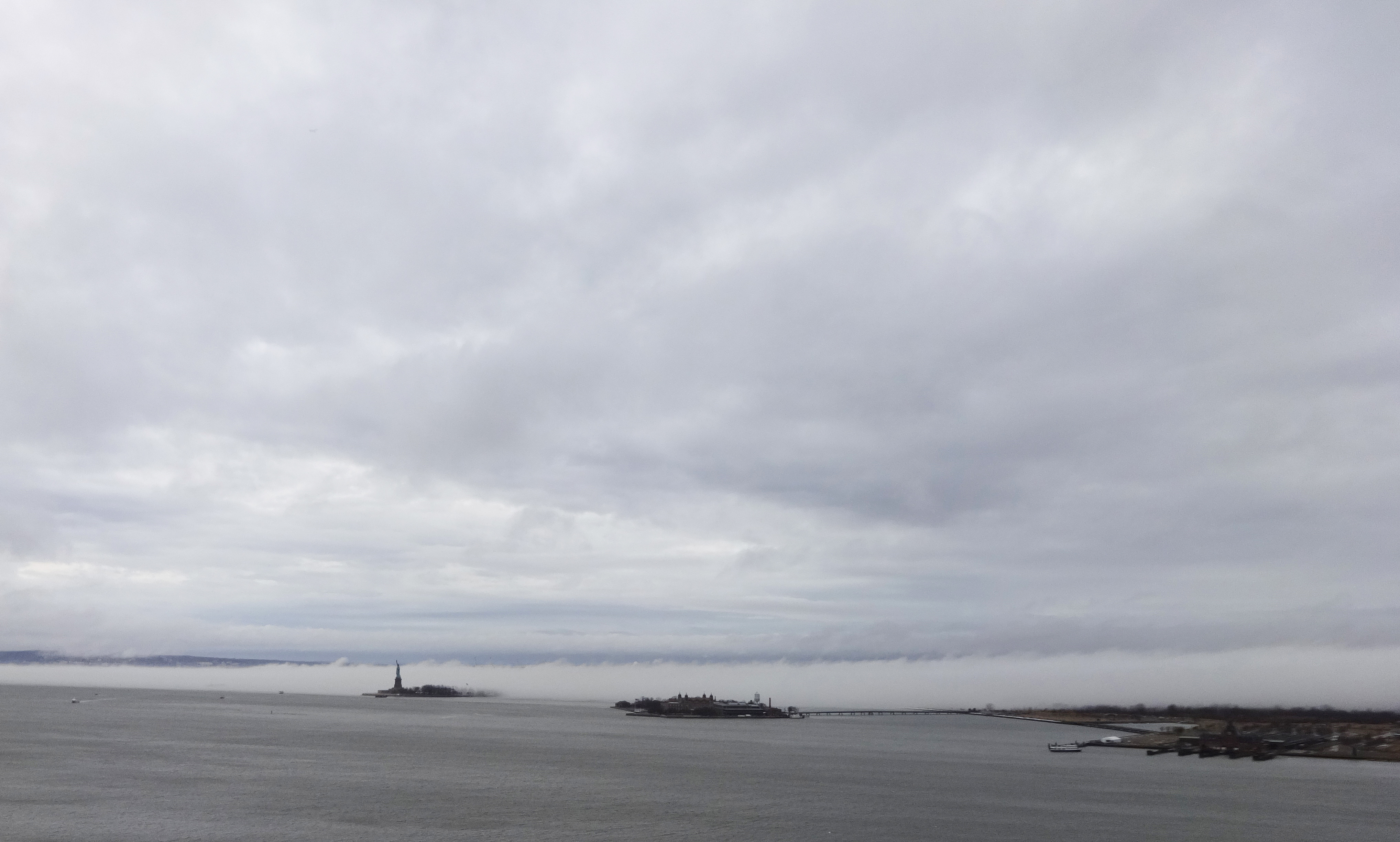 Fog behind Statue of Liberty wide 1-11-2014