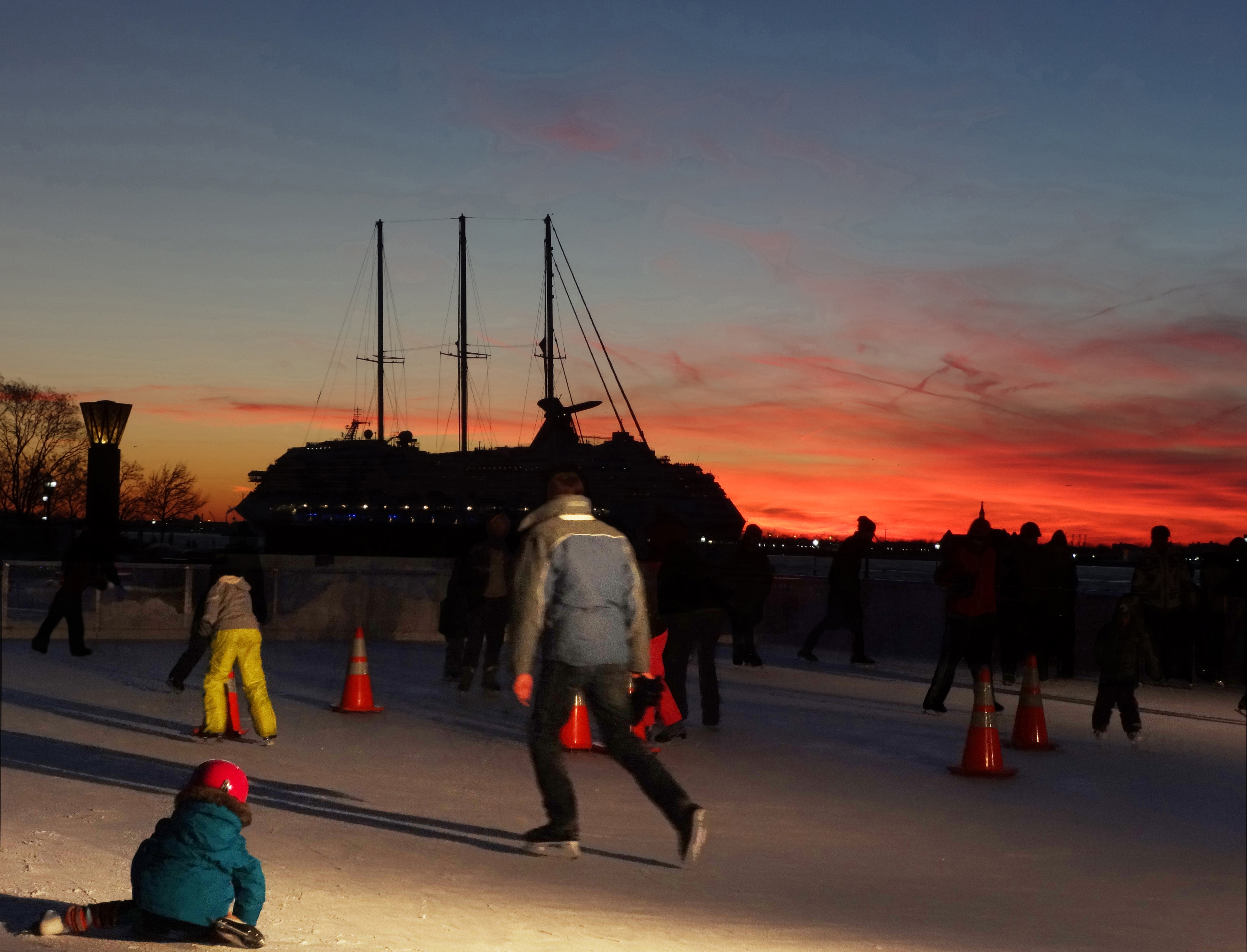 Ice rink and cruise ship sunset
