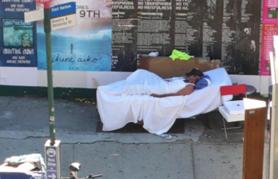 Homeless man on matress