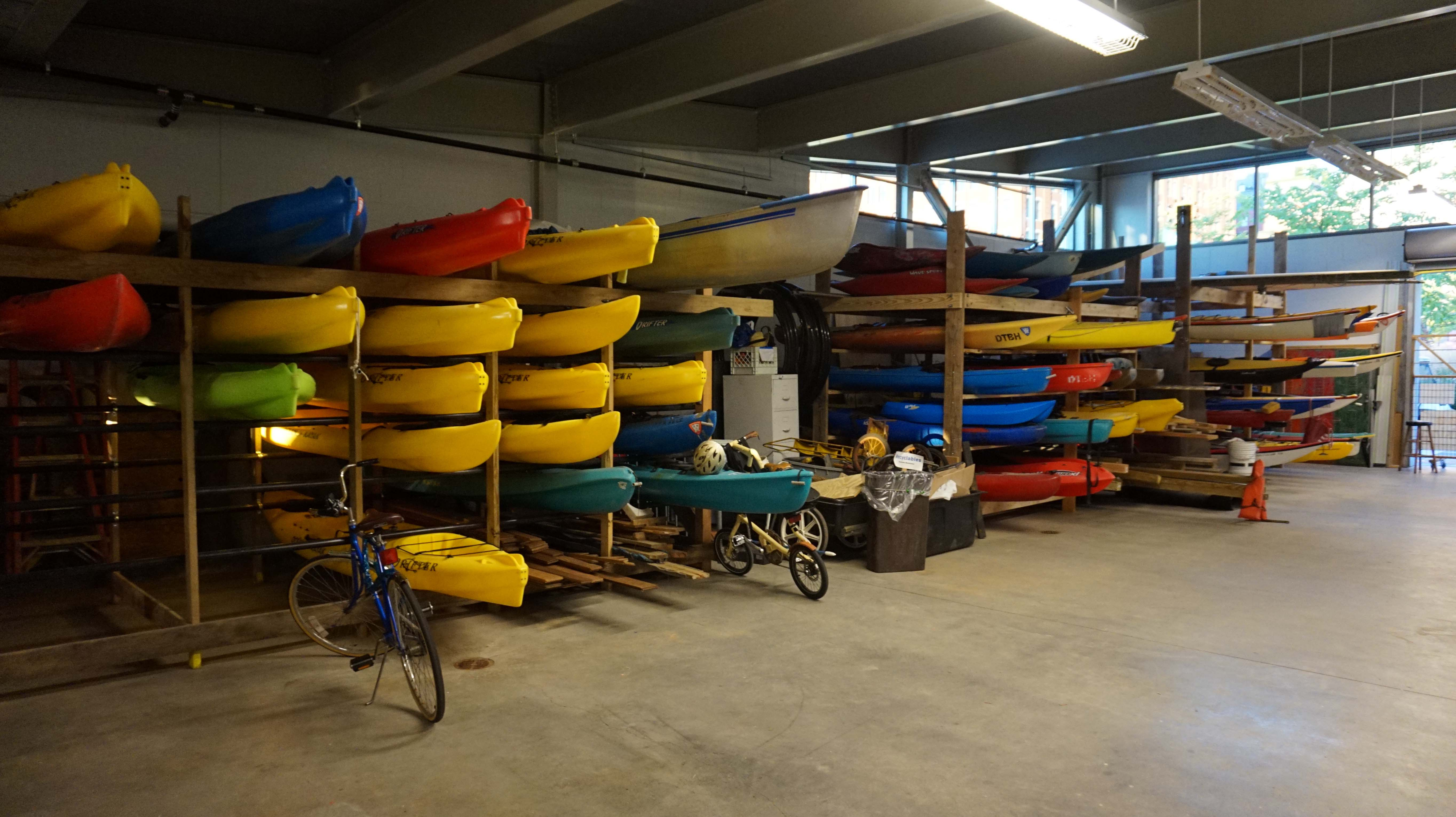 Boat house kayaks on racks