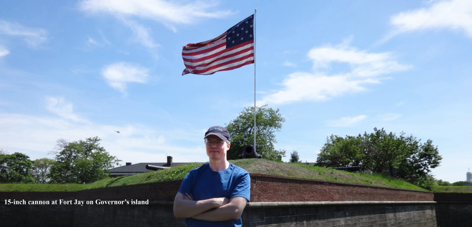 cropped-Patriotic-Greer-by-cannon-and-flag-Governors-Island-21