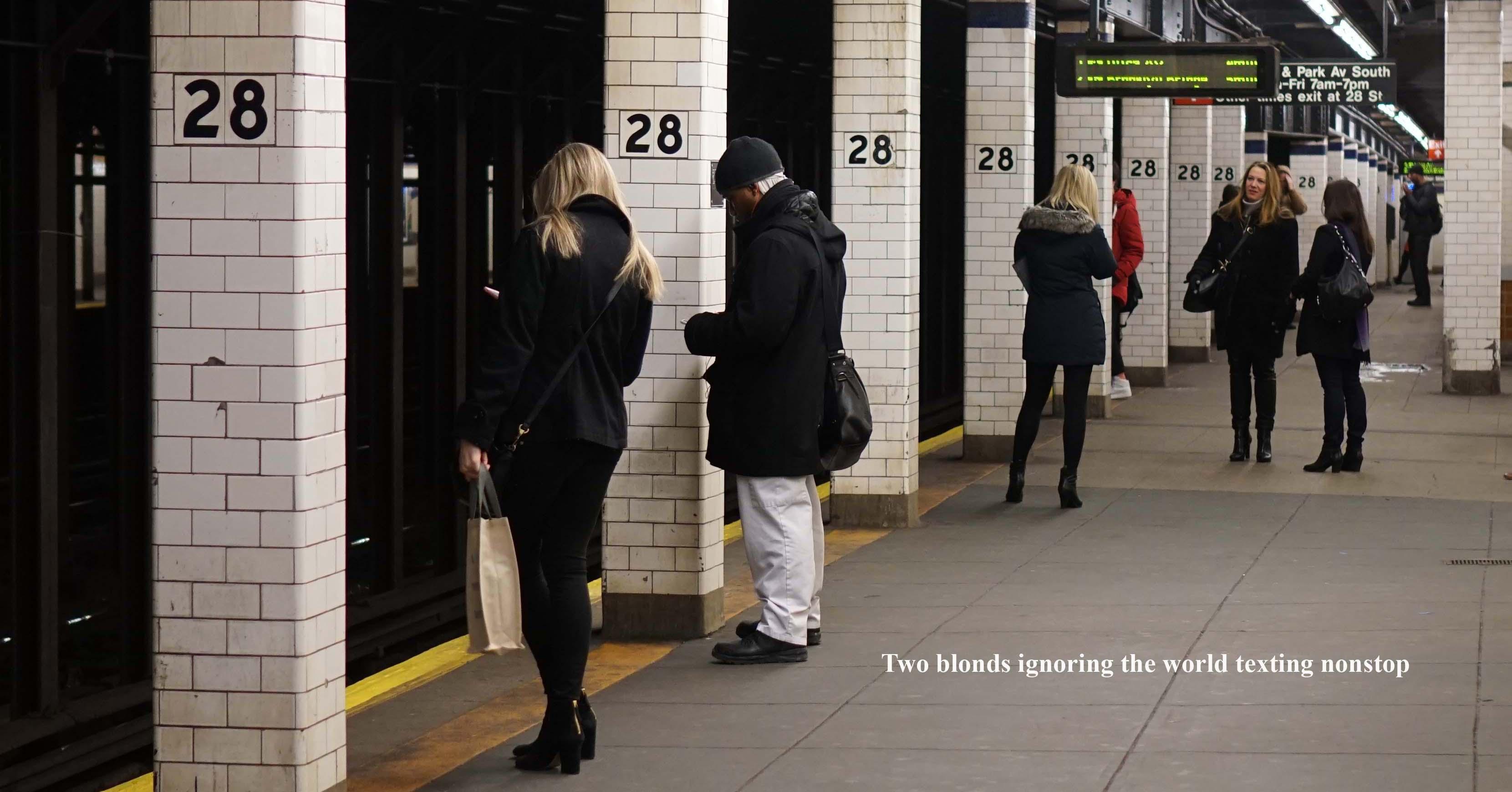 Chicks on subway platform texting