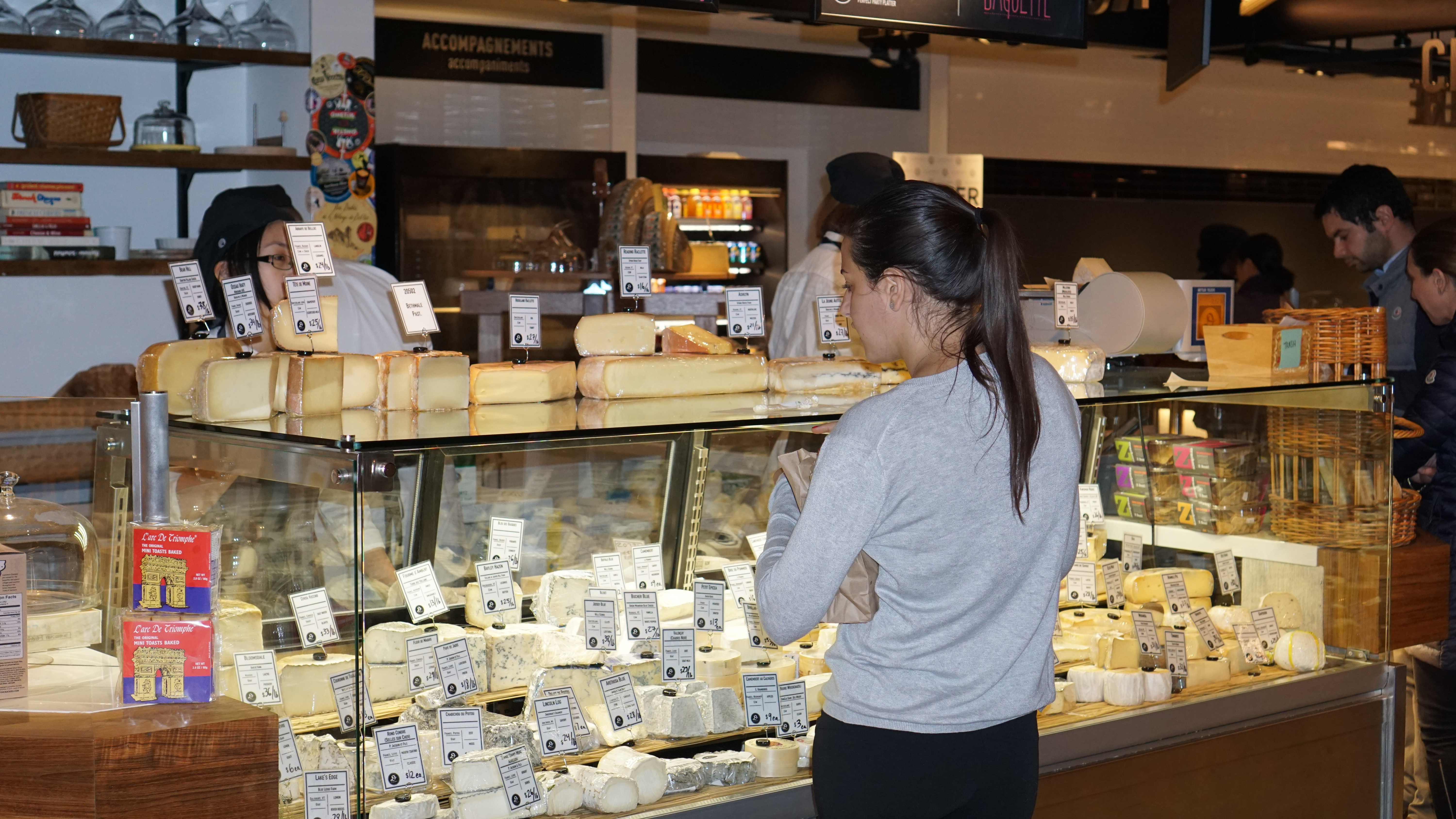 Le District Fromagerie lady at counter shopping