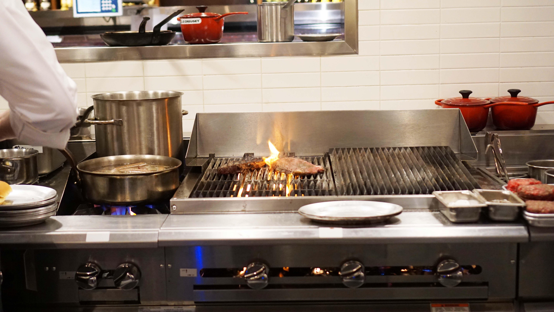 Le District's La Boucherie steak cooking