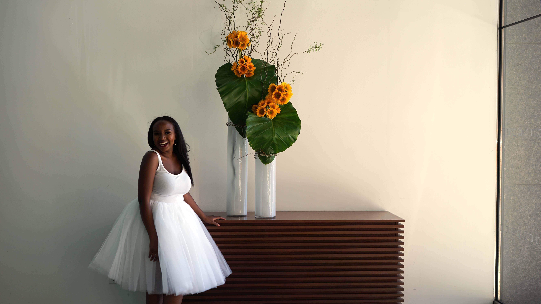 Lady pising in white dress in Conrad hotel