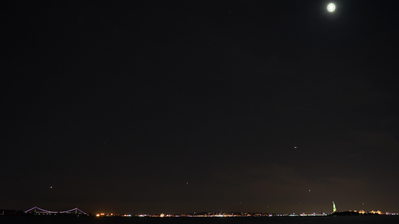 Verazano bridge and statue of Liberty night