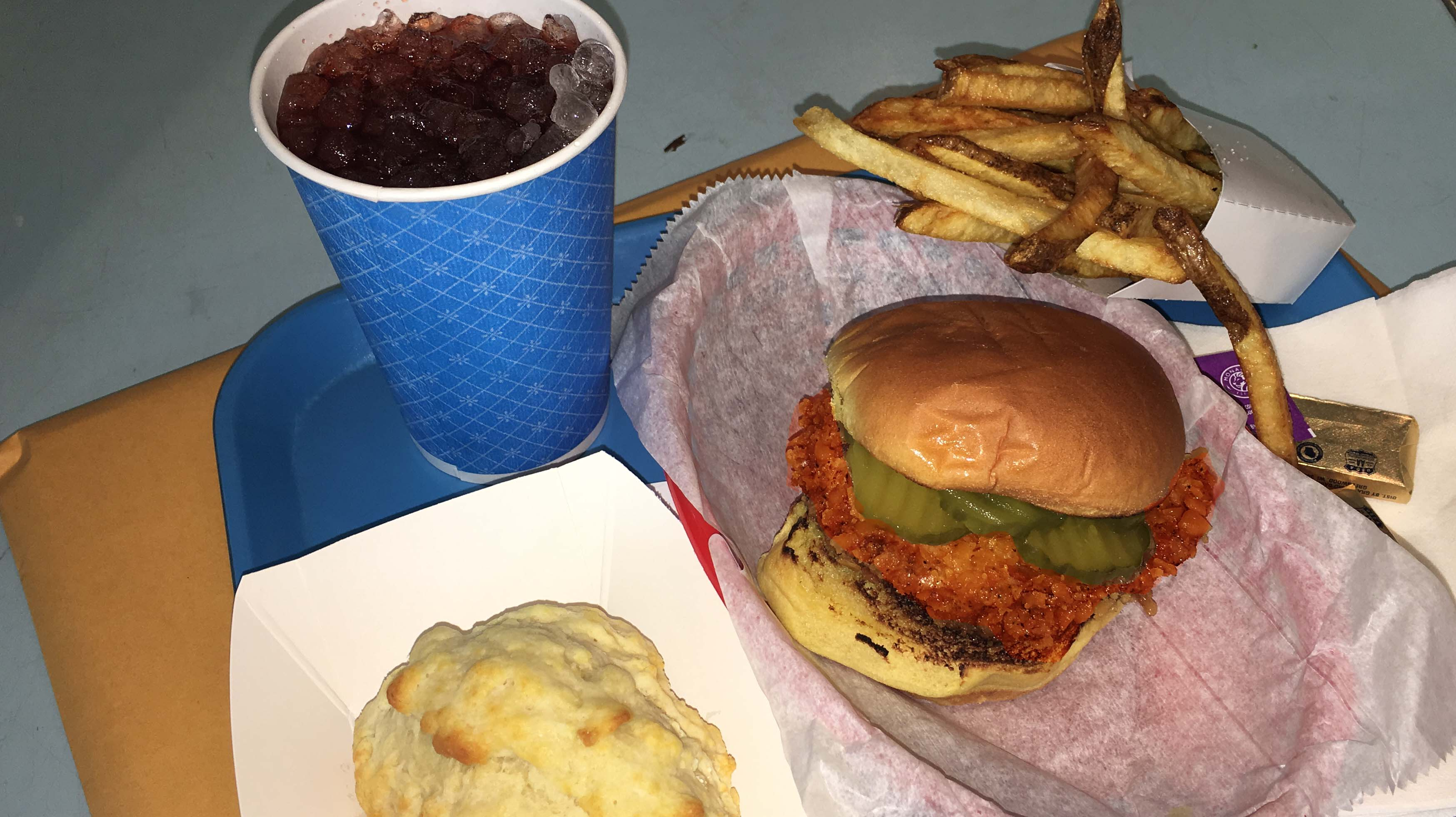 Hill Country fried chicken sandwich with fries biscuit