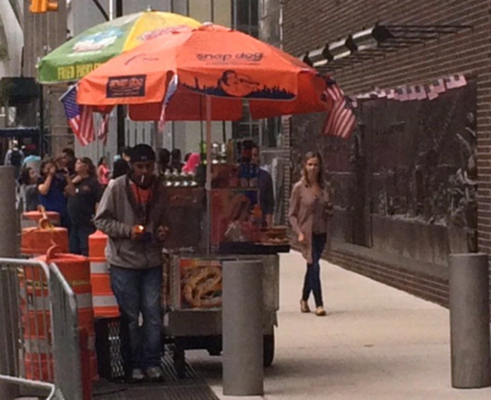 Hot dog vendor on Greenwich and Liberty by Engine 10
