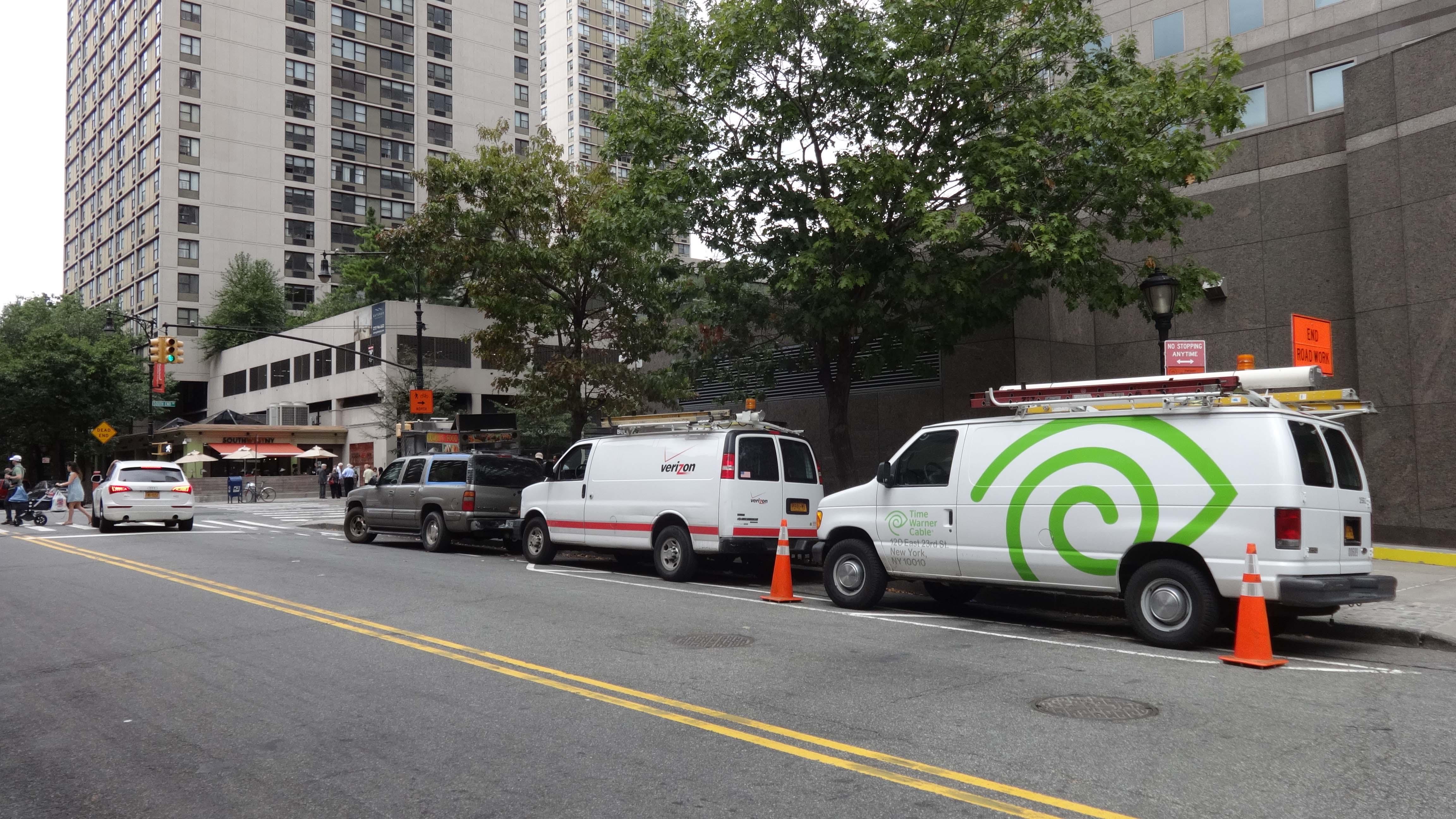 doughnut cart on Albany blocking bike path with SUV