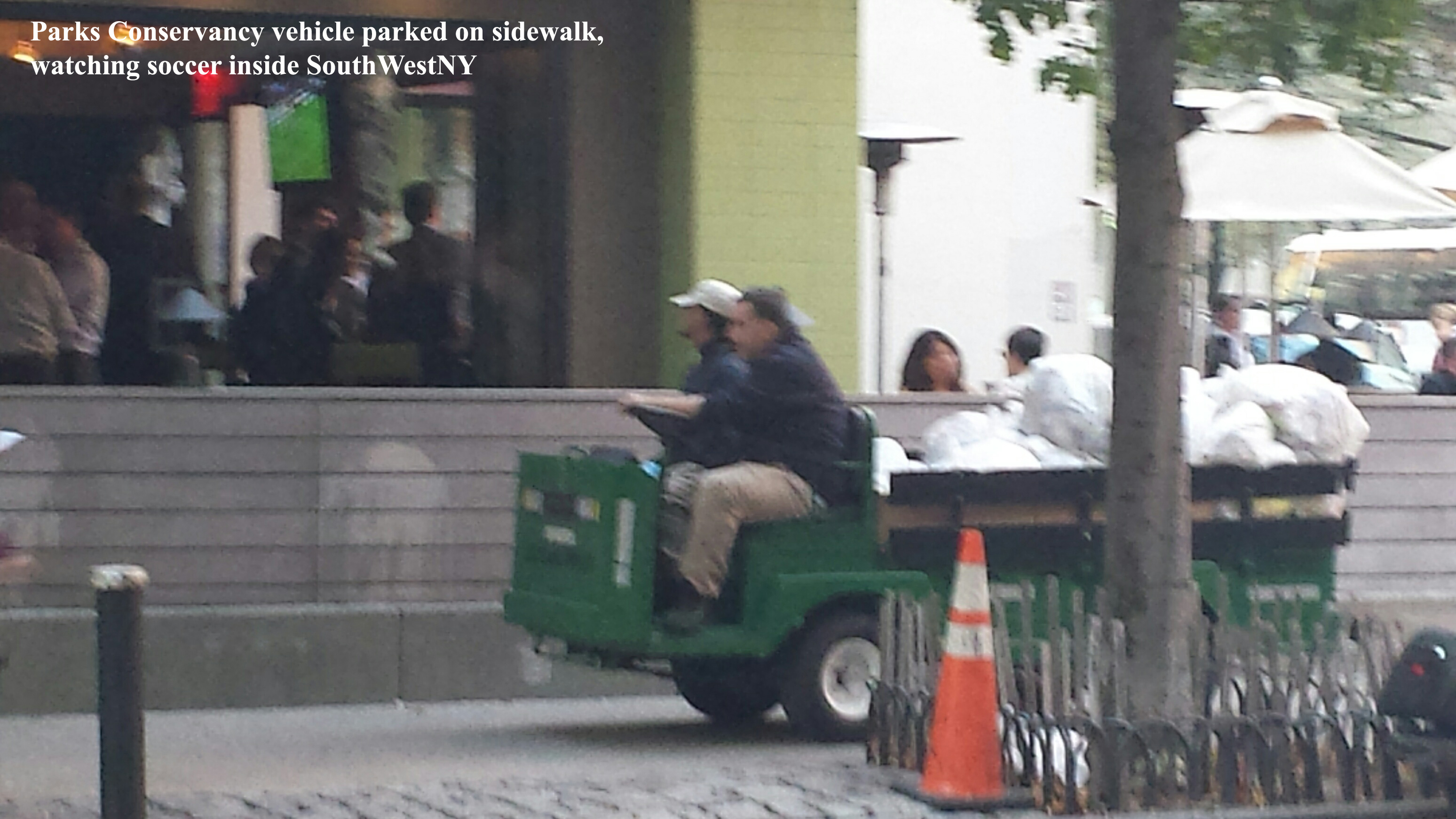 Parks conservancy vehicle on sidewalk