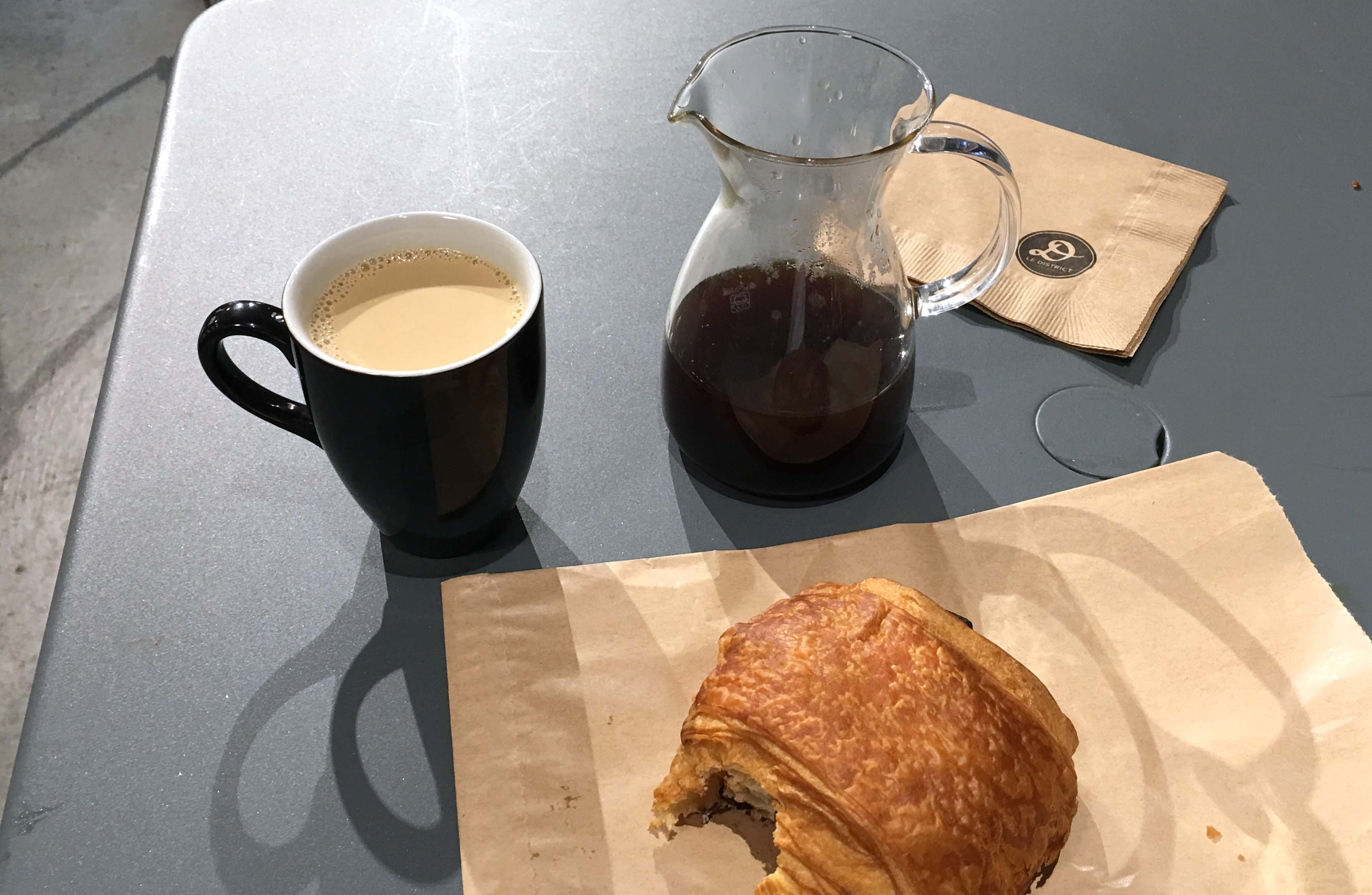 pour over coffee chocolate croissant district