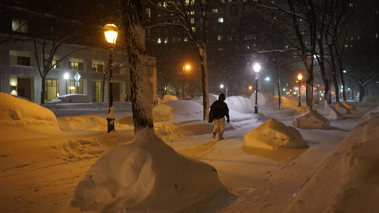 guy in snow at night