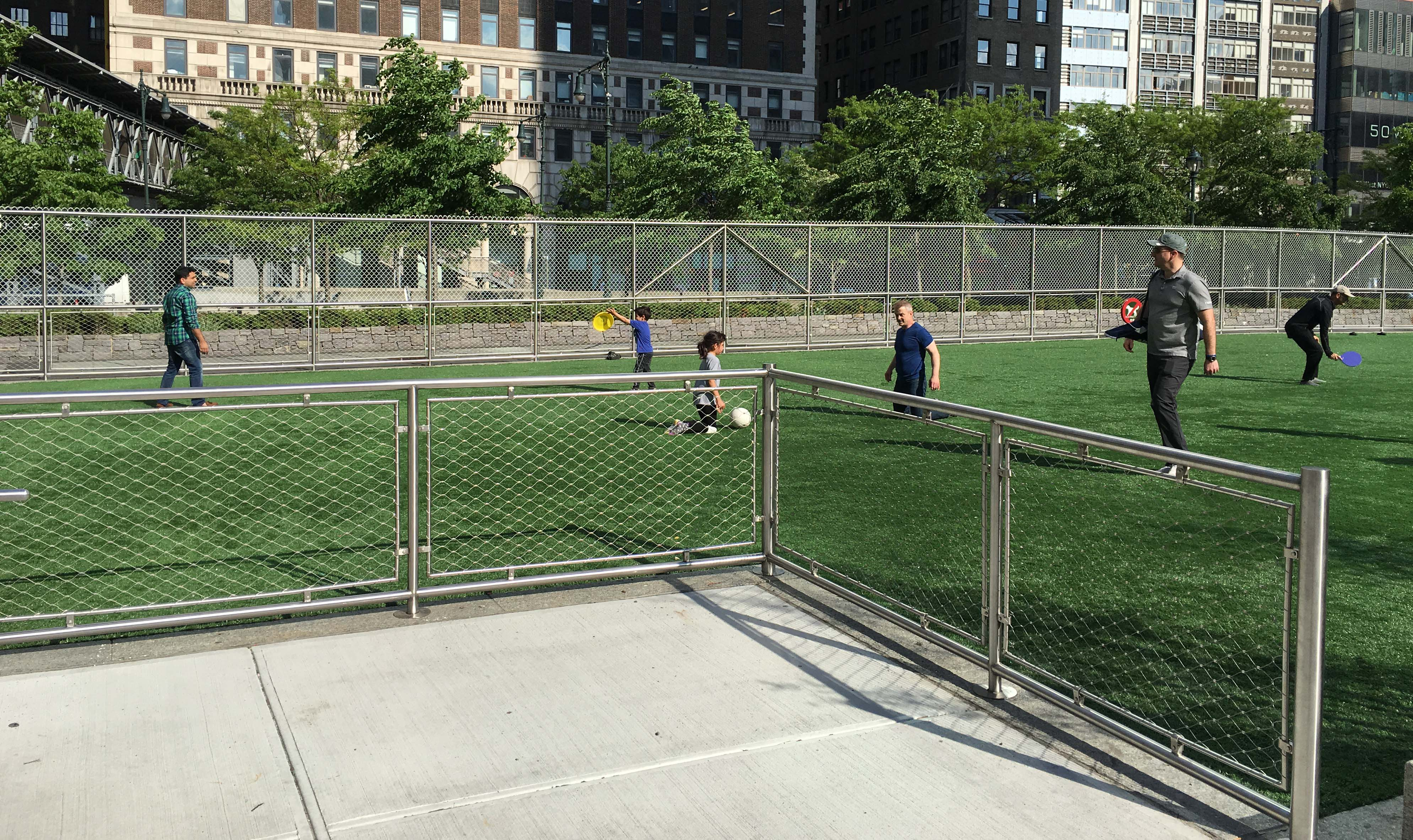 Higher new fence on West Thames turf field