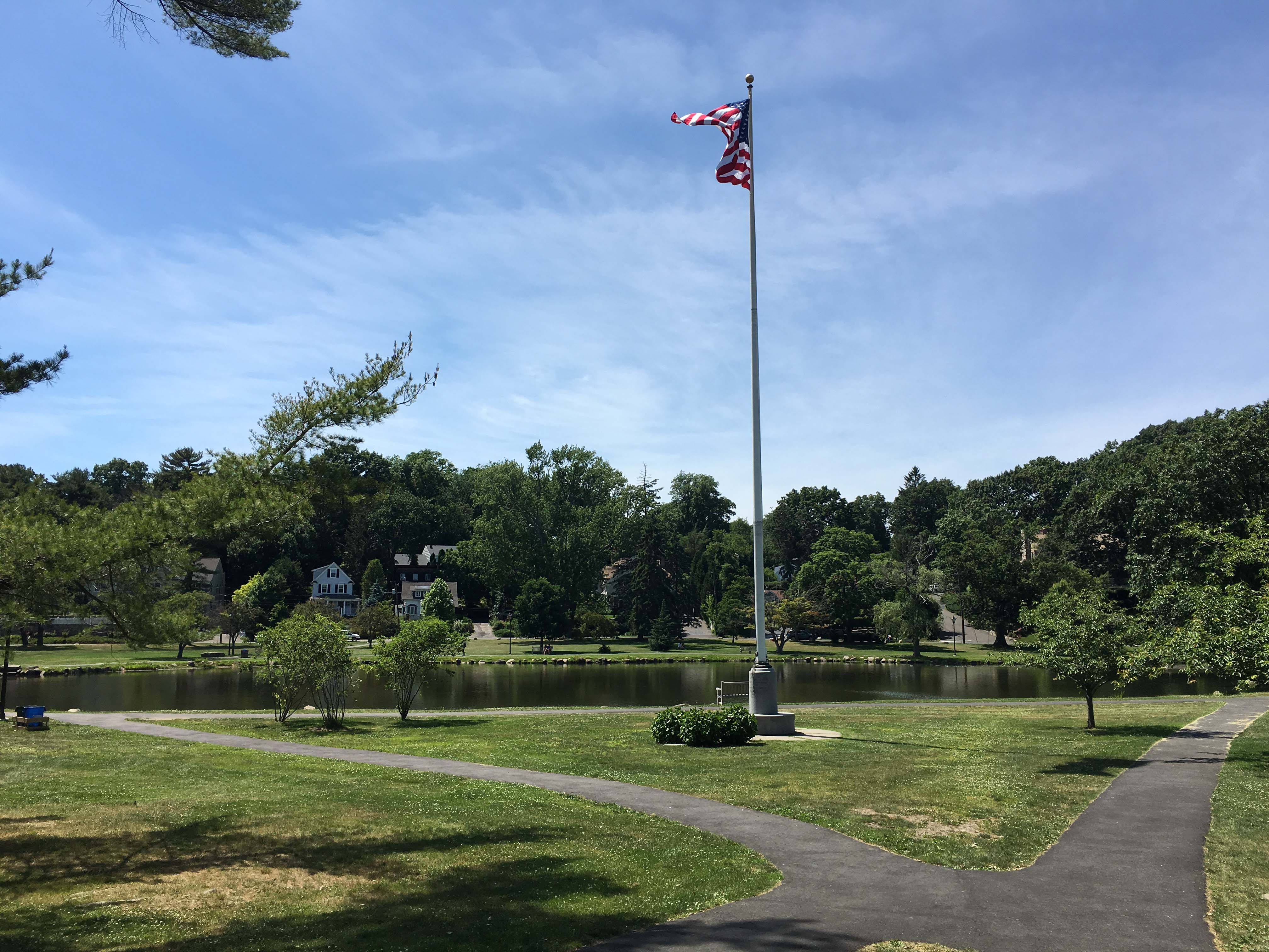 american flag on pole in park old greenwich